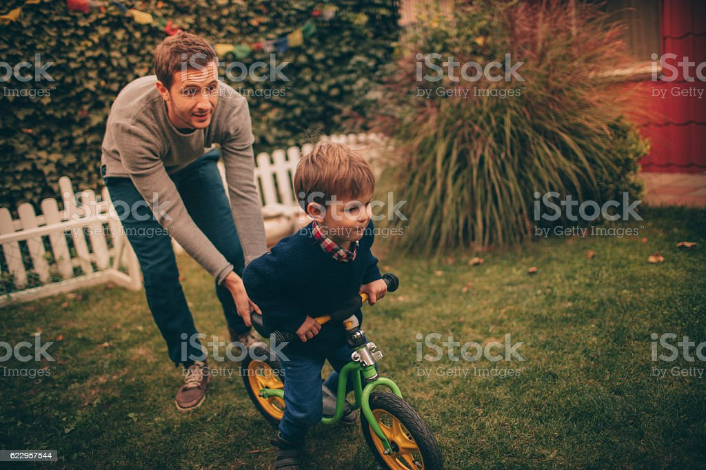 Learning to ride stock photo