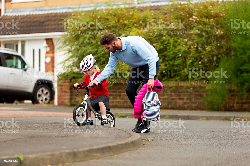 Learning to ride with two wheels. stock photo