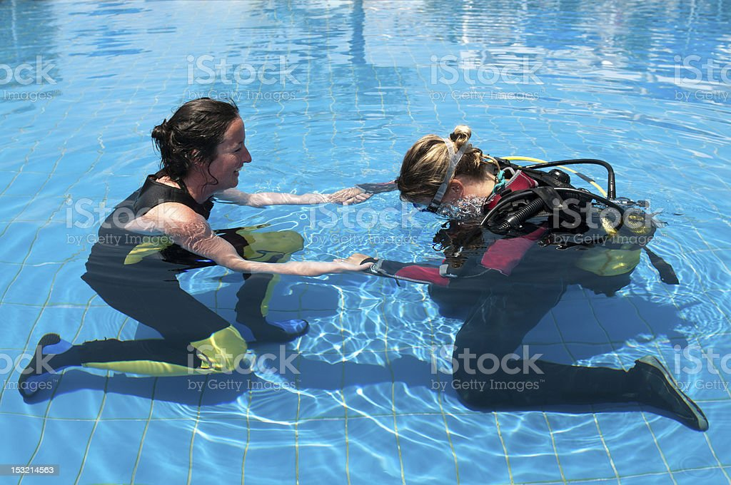 Learning to scuba dive stock photo