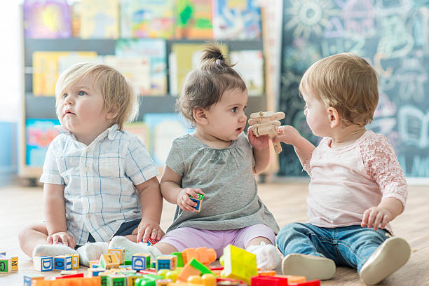 learning to share - preschool building stock photos and pictures