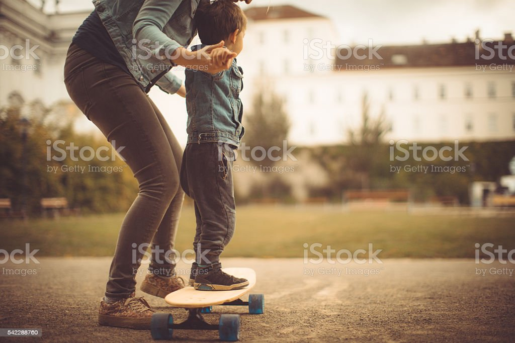 Learning to skate stock photo