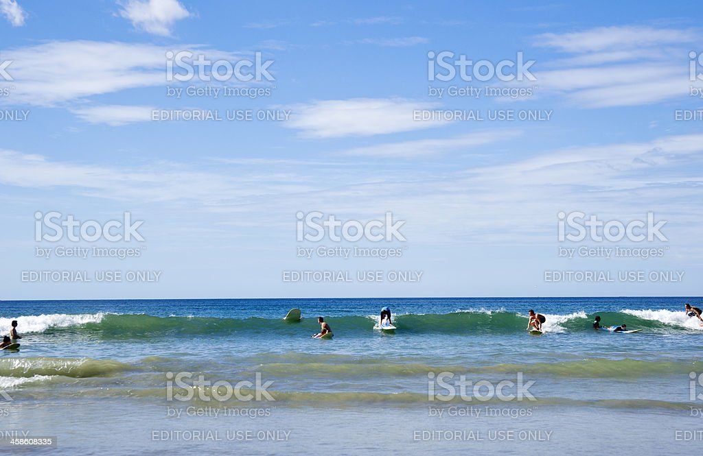 Learning to surf in Tamarindo, Costa Rica. stock photo