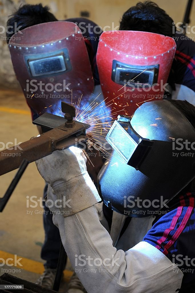 Learning to weld royalty-free stock photo
