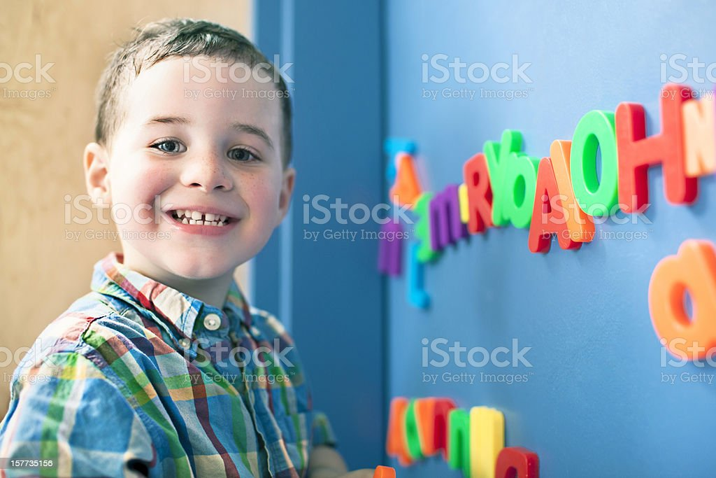 Learning words Little boy learning how to create words in school. 2-3 Years Stock Photo