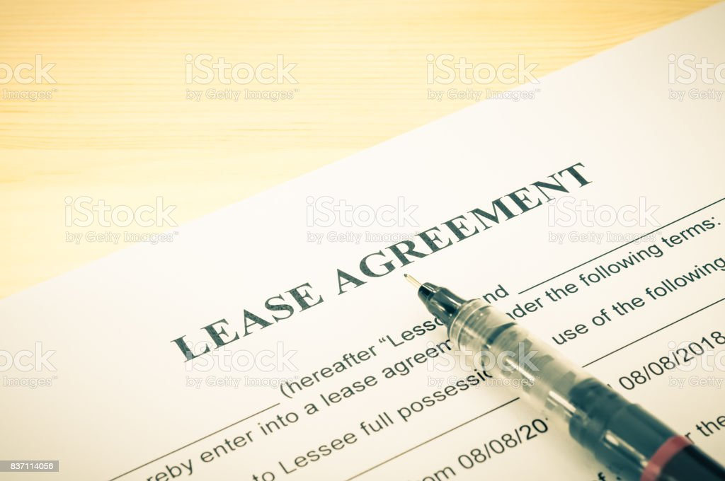 Lease Agreement Contract Document and Pen at Bottom Right Corner Vintage Style stock photo