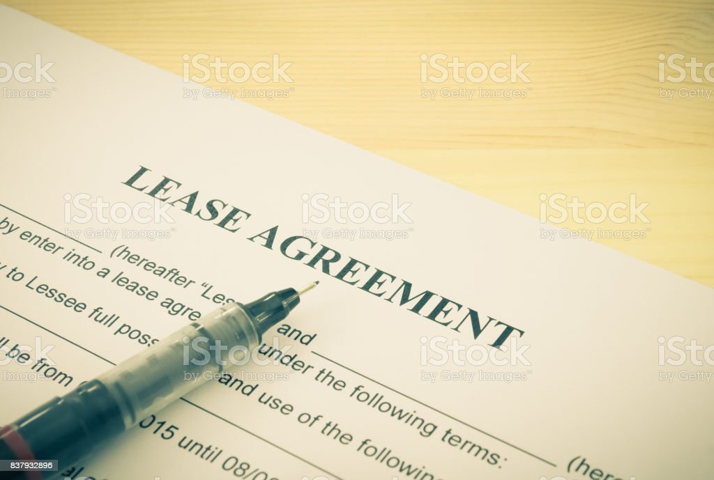 Lease Agreement Contract Document and Pen Bottom Left Corner Vintage Style stock photo