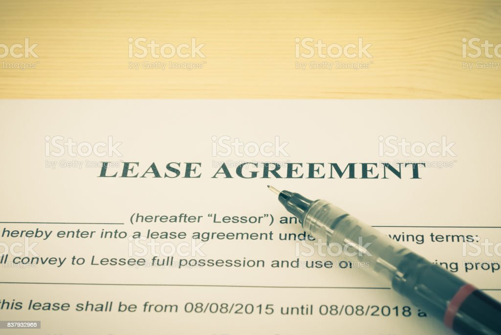 Lease Agreement Contract Document and Pen Horizontal View Vintage Style stock photo