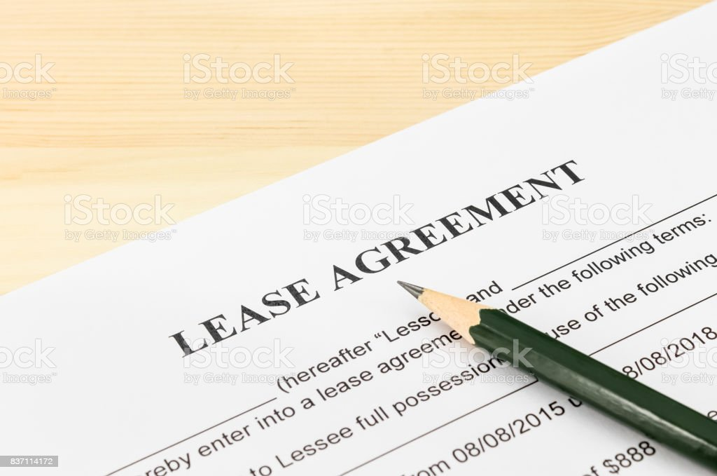 Lease Agreement Contract Document and Pencil at Bottom Right Corner stock photo
