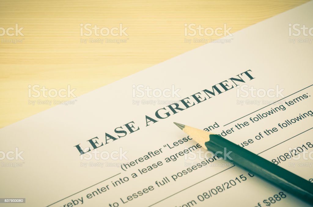 Lease Agreement Contract Document and Pencil at Bottom Right Corner Vintage Style stock photo