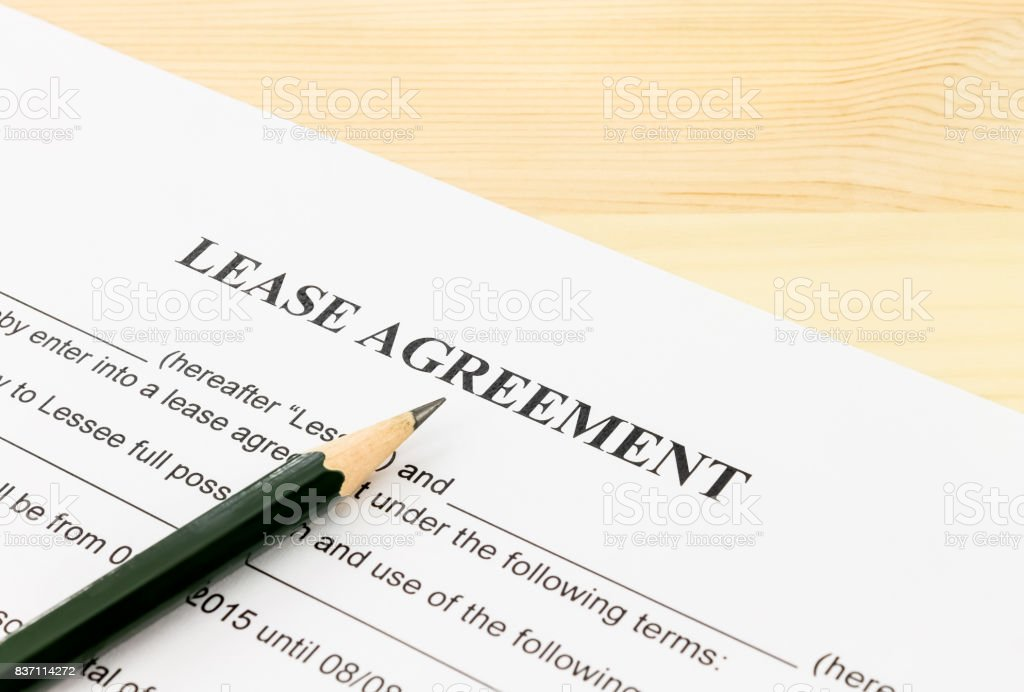 Lease Agreement Contract Document and Pencil Bottom Left Corner stock photo