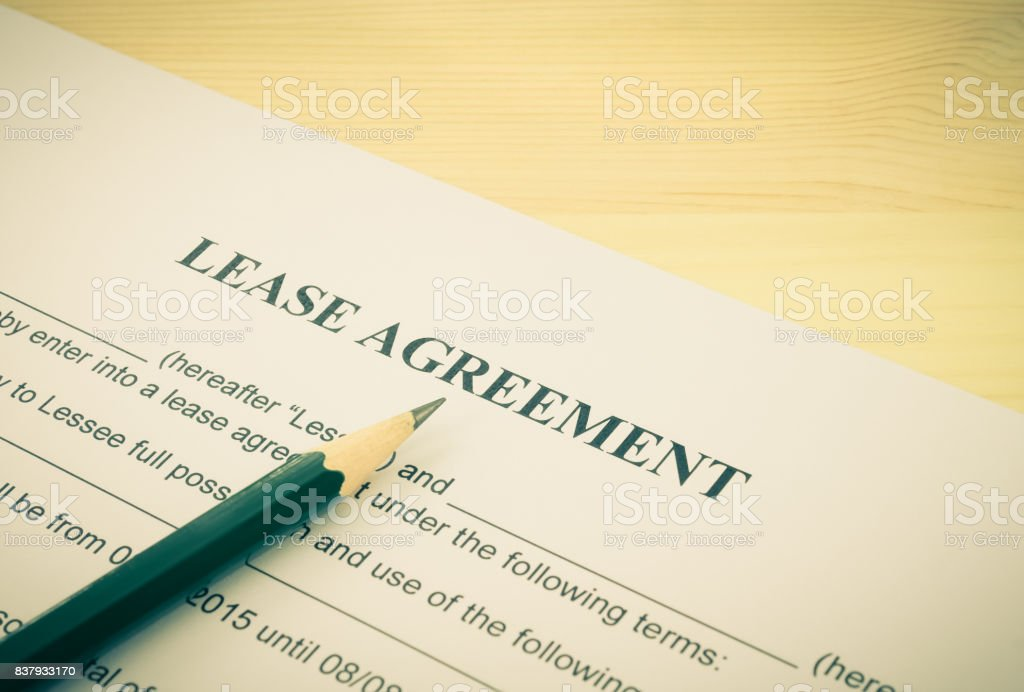 Lease Agreement Contract Document and Pencil Bottom Left Corner Vintage Style stock photo