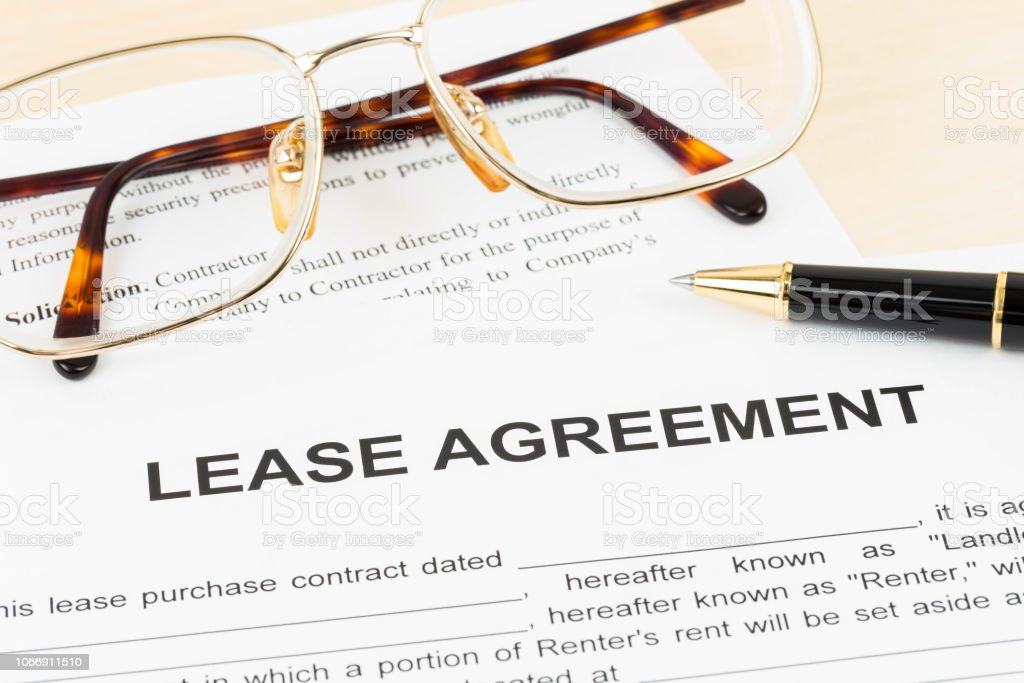 Lease agreement document with glasses and pen