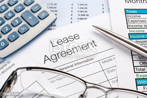 Close up of Lease Agreement Form with pen, calculator
