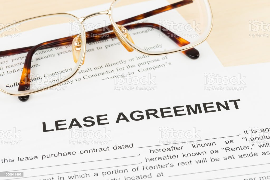 Lease agreement with glasses; document and information are mock-up