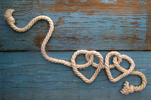 leash  rope into heart shape on wood - knotted wood stock pictures, royalty-free photos & images