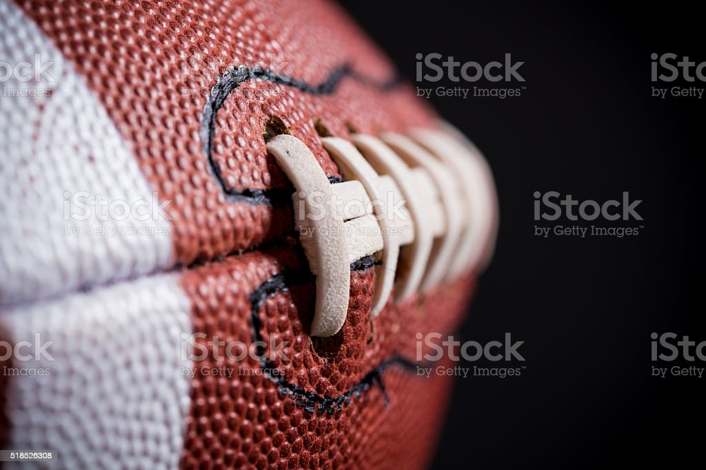Leather American Football on Black background stock photo