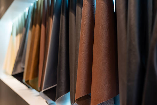 leather and cloth sample hanging on a white wall background - diy leder stock-fotos und bilder
