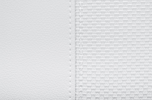 White leather and textile jointed by stitch.