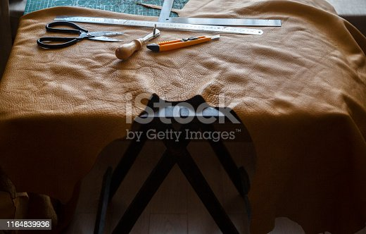 leather and work tool on tailor's table