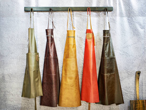 Leather aprons for kitchen and workshop stock photo