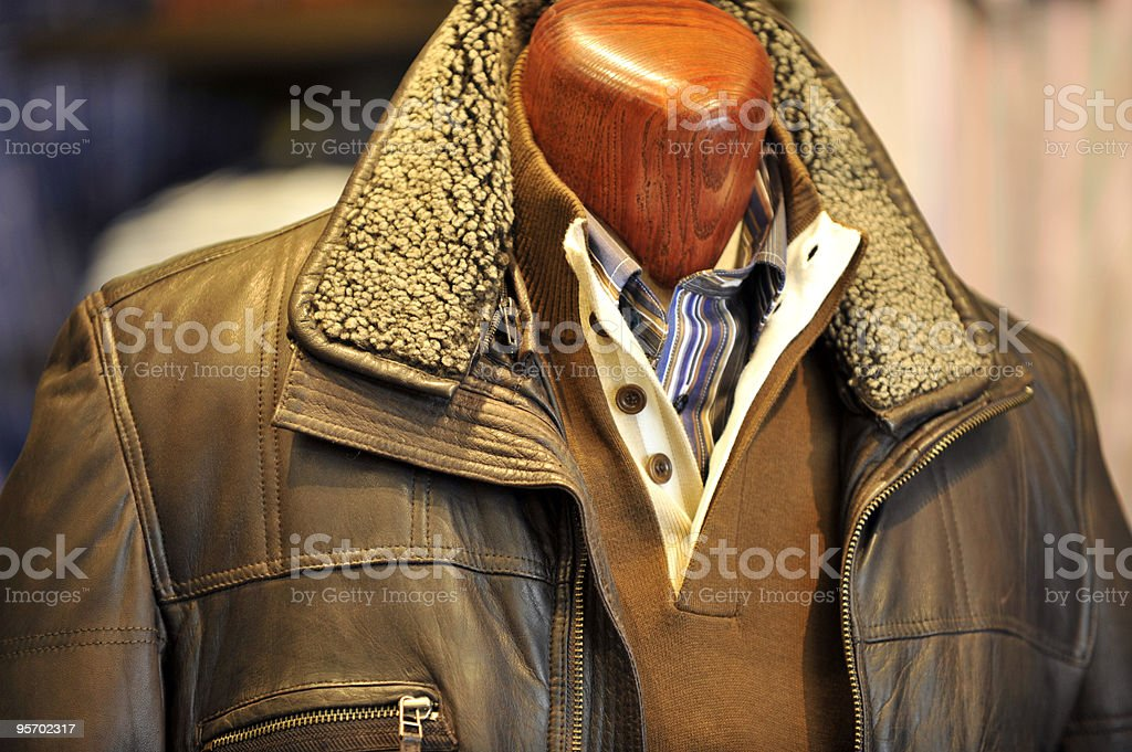 Leather aviator stile jacket on a wooden mannequin. stock photo