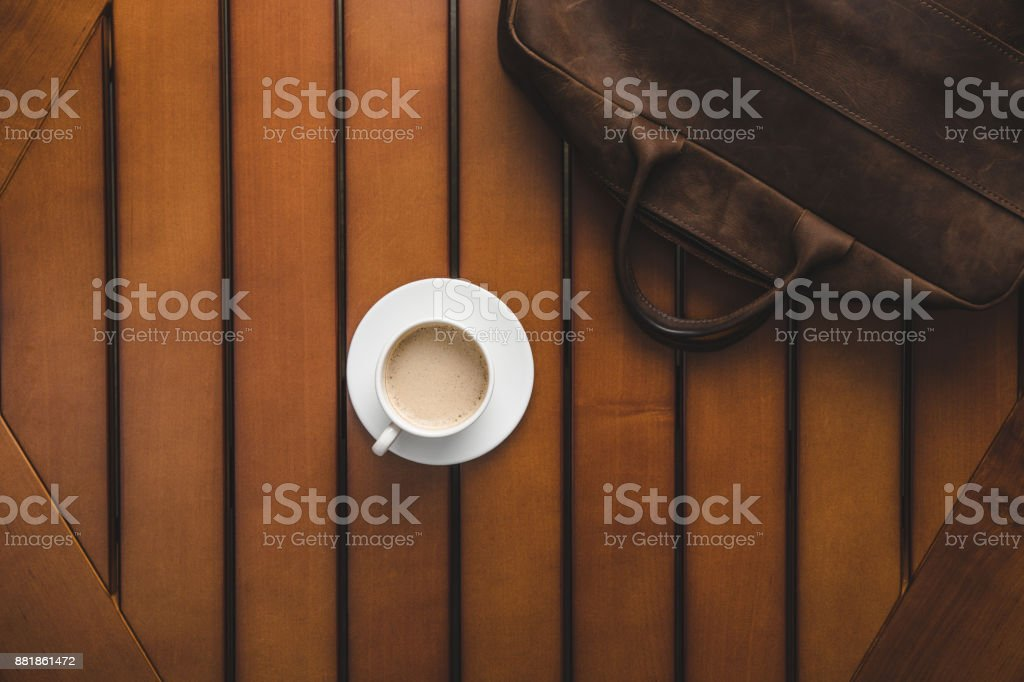 leather bag and coffee stock photo