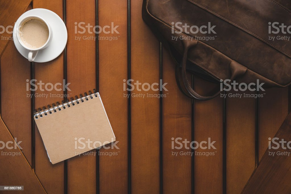 leather bag, notepad and coffee stock photo