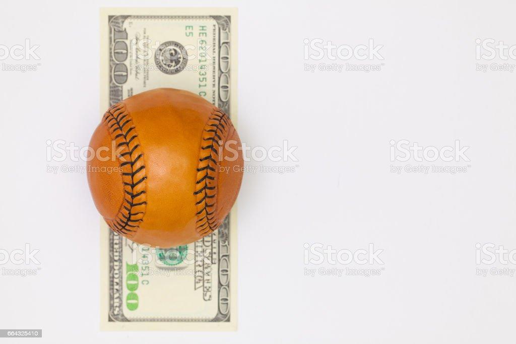 Leather baseball ball and us dollar banknotes stock photo