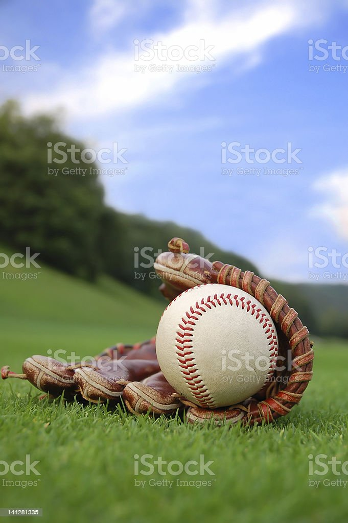 Leather baseball glove holding a baseball ball stock photo