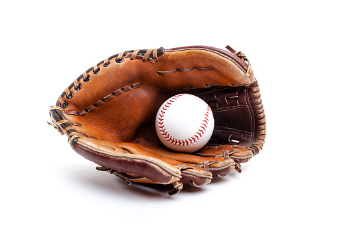 Seasoned leather baseball glove with ball, isolated on white background. Can also be used for softball or T-ball.