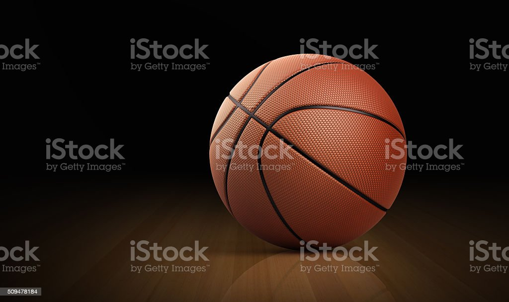 Leather Basketball Ball On Hardwood Floor stock photo