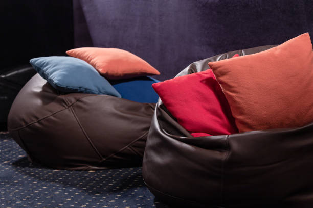 Leather beanbags with pillows. Cinema of open space office