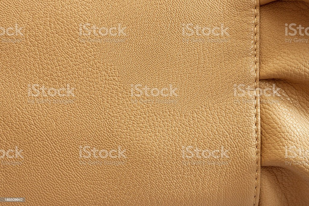 Leather beige background with the frill royalty-free stock photo