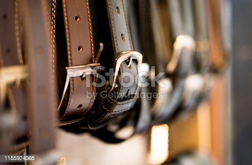 Leather belts in a store.