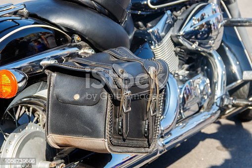 Leather biker bag on a motorcycle close-up. Concept travel on a motorcycle