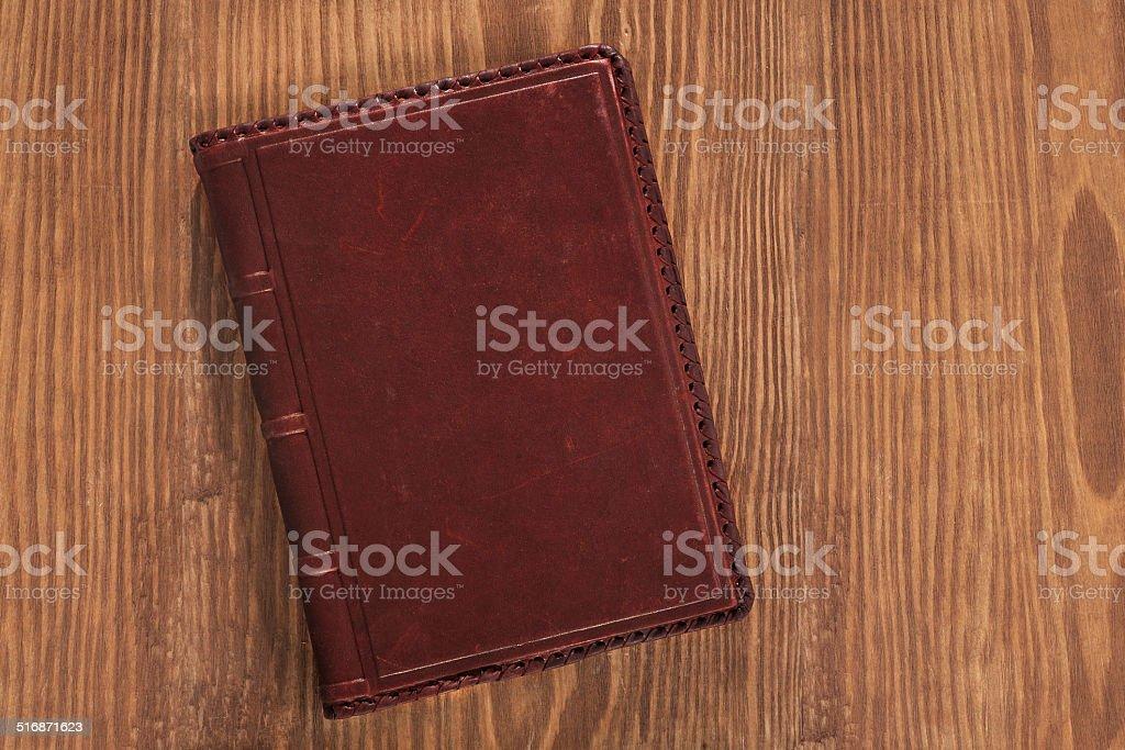 Leder Buch auf Holz-board – Foto
