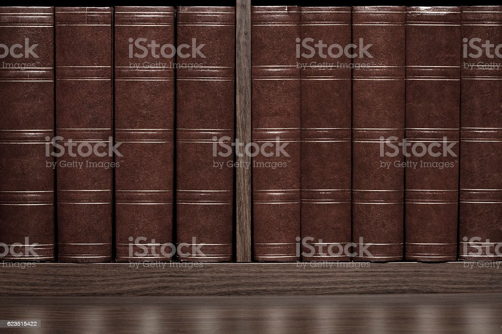 Leather books in a row stock photo