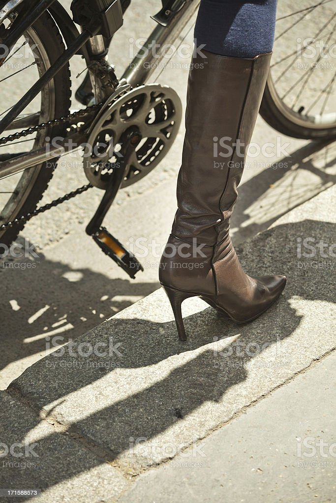 Leather boot female bicycle royalty-free stock photo