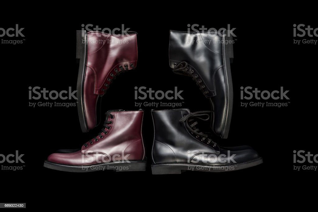 Leather boots isolated on black background stock photo