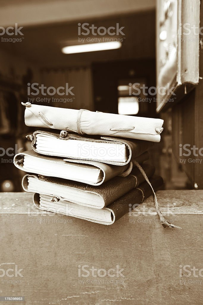 Leather bound antique books on open windowsill royalty-free stock photo