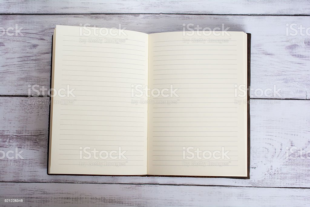 Leather Bound Book Open on White Barn Board Floor stock photo