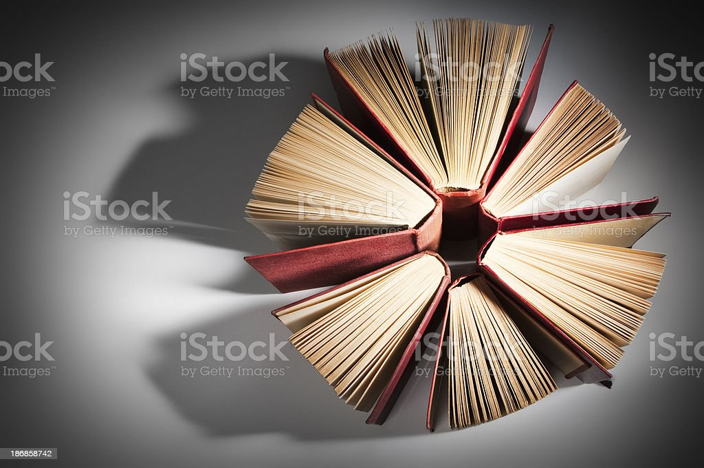 Leather bound books standing up forming a circle stock photo