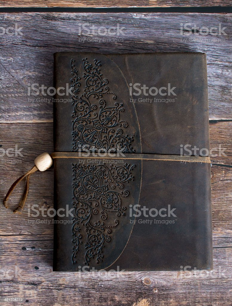 Leather Bound Journal Book Barn on Board Floor Straight On stock photo