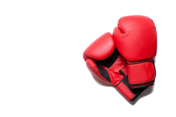 Leather box equipment for fight and training. Pair of boxing gloves lying on each other. Combat and fight concept. Boxing gloves in red color isolated on white background stock photo