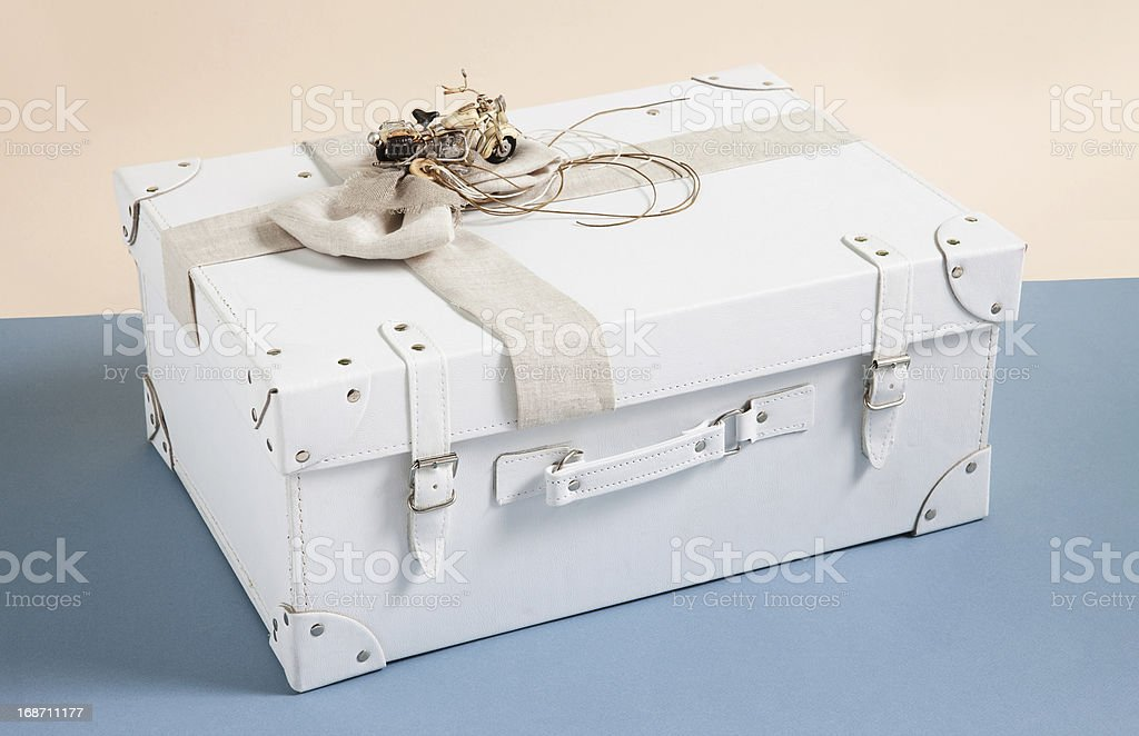 leather box for baptismal clothes on beige and blue background royalty-free stock photo