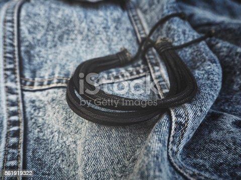 Leather bracelet on jeans
