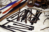 Leather bracelets and necklaces in medieval market, fashion accessories