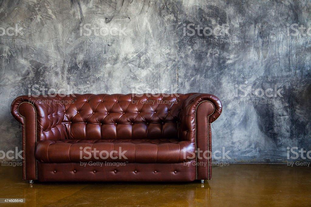 Leather brown sofa in urban loft interior stock photo