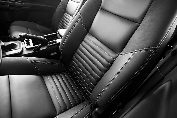 leather car seats close up - auto interieur stockfoto's en -beelden