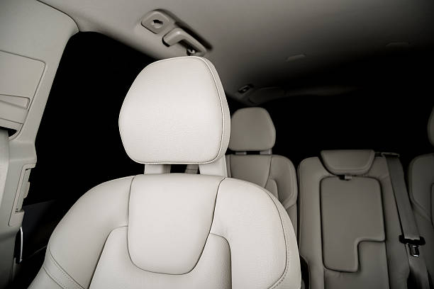 leather car seats  detail - kopfstütze stock-fotos und bilder